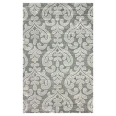 Hand-tufted rug with a damask-inspired motif.