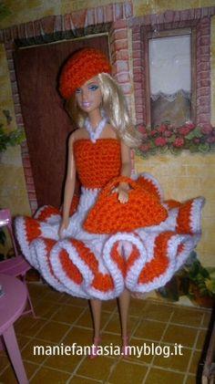 come fare un vestito barbie uncinetto di lana facile e bellissimo con tante balze e coordinato di cappellino e borsetta all'uncinetto, ho preferito la lana al cotone perchè il vestito lo usano le mie bambine per giocare e quindi è più resistente Barbie Dress, Barbie Clothes, Barbie Stuff, Ken Doll, Barbie And Ken, New Years Eve Party, Chrochet, Fashion Dolls, Free Pattern