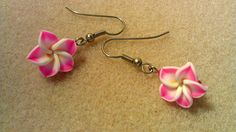 These handmade earrings are made with a small hot pink, yellow, and white polymer plumeria bead and hot pink seed beads. They have fish hook
