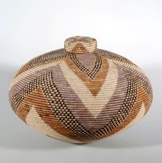 Africa | Basket by Zulu master weaver Beauty Ngxongo. ca. 1991, South Africa. | Beauty is well known for her 'isichumo' baskets, a water tight vessel. | Beauty uses native grasses and palm leaves to make her baskets, and her dyes are derived fro fruits, leaves, bark and roots.