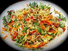 Shredded salad with Tuna! Zucchini, red onion, cabbage,carrot, tomato,sugar snap peas,tinned tuna, grated parmigiano all dressed in salt, olive oil and apple cider vinegar!