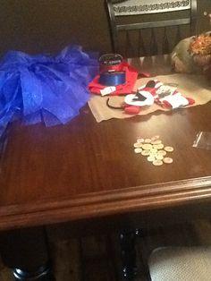 DIY skirt, red shirt, headband, black and white felt, red knee socks, mustaches, ribbon and there u got Mario!