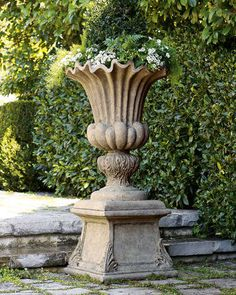 An open urn makes a gorgeous alternative to a typical garden pot. This one is part of a set from Neiman Marcus. Though it looks like solid stone, the urn and column are made from a blend of crushed stone and resin for lightweight durability.