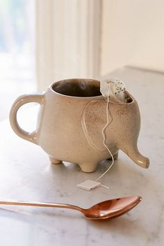 Shop Plum & Bow Elephant Tea Mug at Urban Outfitters today. We carry all the latest styles, colors and brands for you to choose from right here. Ceramic Mugs, Ceramic Pottery, Stoneware, Coffee Cups, Tea Cups, Coffee Beans, Urban Outfitters, Elephant Mugs, Cute Mugs