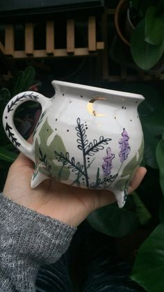 For those firmly rooted into the earth I introduce the Green Witch mug. nature is medicinal, nature always provides. With the coming of spring this mug blooms as the earth reawakens. Each leaf, flo. Ceramic Pottery, Ceramic Art, Baby Witch, Witch Aesthetic, Kitchen Witch, Cute Mugs, Deco Design, Pottery Painting, Tea Pots