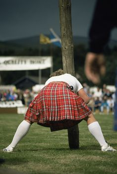 Tossing the Caber   by VisitScotland