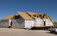 SIP: A structural insulated panel is usually made of expanded polystyrene insulation glued between two sheets of oriented strand board (