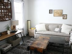 LOVE That wooden coffee table. Also kinda diggin the overall style of the room. Simple but not lacking character.
