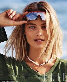 Margot Robbie goes topless on beach for Elle cover shoot | Daily Mail Online