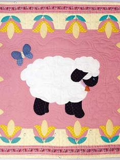 Free Sweet Lambs for Baby Quilt Pattern -- Download this free, applique baby quilt pattern, featuring a cute little lamp and tulips, from FreePatterns.com.