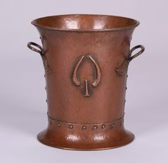 I just discovered this Gustav Stickley Hammered Copper Champagne Bucket on LiveAuctioneers and wanted to share it with you: www.liveauctioneers.com/item/43483910