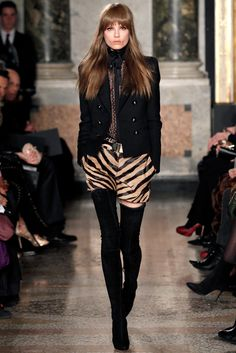 "On the runway of Emilio Pucci Fall 2013 Ready-to-wear Collection. Feline, that's the perfect word. A kind of working girl and wild tigress the Emilio Pucci's woman doesn't know what ""doubt"" means. Looking far off she feels sensual, not provocative. She is only classy like a woman... [...]  For more : midnightandclassynight.wordpress.com"