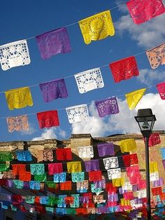 Mexican inspired buntings (can buy similar ones here: http://www.casabonampak.com/spmepapapiba.html)