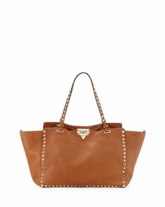Rockstud Medium Pebbled Tote Bag, Tan by Valentino at Neiman Marcus.