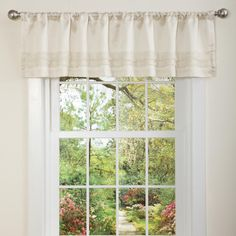 The romance of a traditional window covering can be yours with this pretty pocket valance that slips onto your existing curtain rod to dress up your window. This 100 percent polyester piece can be used alone or with pretty curtain panels.