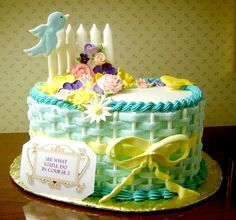 - This was a display cake I brought to a Wilton Instructors Annual Meeting for one of their instructor contests. It won first place. I used teal for the basket weave and a sampling of Course 2 royal icing flowers as well as a color flow picket fence and bird and butterfly.