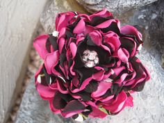 This Shocking Pink and black Satin and Chiffon Print Flower is perfect for Valentines Day or any day for that matter. It will look great on a sweater, blouse, purse, belt or anywhere your imagination takes you. The beautiful pink rhinestone ball embellishment makes this gorgeous pin a nice choice for Valentines day.
