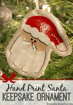 Hand Print Santa Salt Dough Keepsake Ornament perfect to hang on your Christmas Tree or give as a gift.