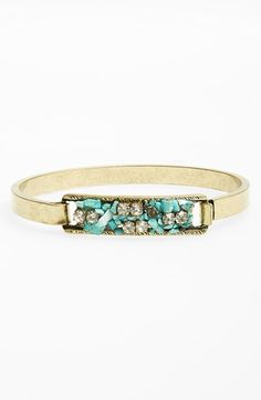 love the skinny band and the rough turquoise stones in this bracelet that is perfect for stacking!