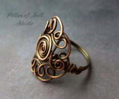 This handmade wire wrapped ring is an eye-catcher. This ring is made with solid copper wire in any size you need. Let me know what size you want in the notes section at checkout. Copper wire is shaped and hammered to create your ring in the size you choose. Then I antique it and give it a clear coat to help prevent tarnishing. Each ring will vary slightly because each one is formed by hand. I really love this design and I wear this ring a lot, it is quite comfortable.    I do my best to take…