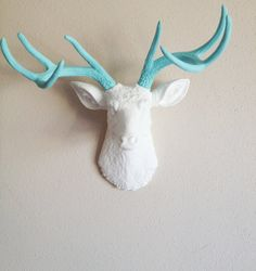 I MIGHT actually let michael hang his deer if I can paint them tiffany blue!  White and Robins Egg Blue Deer Head Wall by BananaTreeStudios, $150.00