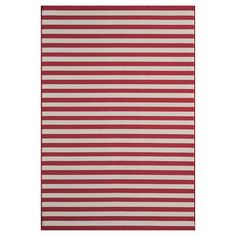 Add a burst of depth and modern charm to your living space with a Stripe, Indoor/Outdoor Rug in Red. Boasting thin, on-trend red and tan stripes, this versatile area rug is just the piece you've been searching for to liven-up your home's décor. The low-pile, tightly looped, weather-resistant weave is soft, yet durable. The large surface area, combined with the hardwearing construction makes it a great fit on hard-surface floors throughout your home or on patios, decks an...