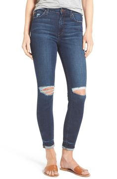 Distressed edges and ripped knees define the cool-girl character of cropped high-waist skinny jeans cut from incredibly soft and gravity-defying Flawless denim.
