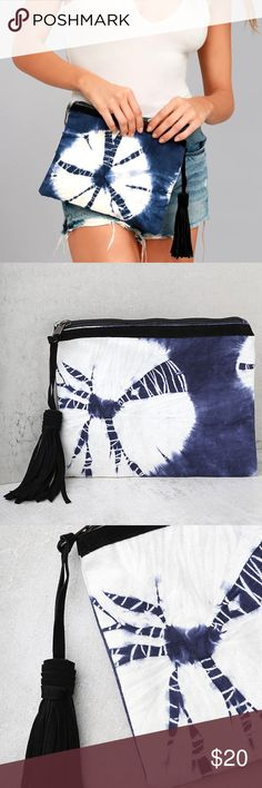 """Blue and White Tie Dye Clutch Blue and white tie-dye decorates this woven cotton clutch. Black genuine leather tassel zipper pull secures your goodies inside the roomy interior. Lined. Clutch measures 10"""" wide, 8"""" tall, and 0.25"""" deep (relaxed). Shell: 100% Cotton. Linning: 100% Polyester. Zipper Strap: 100% Genuine Leather. Imported…"""