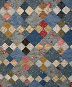 knot garden quilt pattern alternates four-patch squares with plain squares, always keeping light-colored squares in a line like stepping stones in a garden