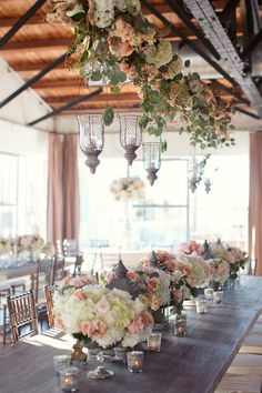 All in the details! We love everything from the low centerpieces to the hanging floral with candles! #bflive www.bellafloraofdallas.com  Read More: http://www.stylemepretty.com/2014/05/06/urban-english-garden-inspired-wedding/