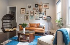 Before & After: Tiffany Gives A New Orleans Shotgun New Life (a gallery wall that incorporates a buck)