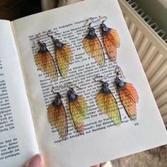 """ιғ ησтнιηg εvεя cнαηgε∂, тнεяε ωσυℓ∂ вε ησ sυcн тнιηgs αs вυттεяғℓιεs."" - Wendy Mass ✶ ⋆ Pretty iridescent fairy wings in orange with a…"