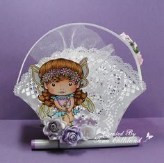 Copic basket using the La-La Land Crafts - Daisy Faerie Marci stamp.  Made by Tina
