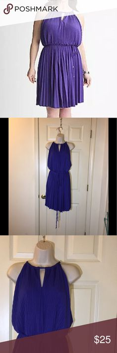 NWT Lane Bryant Pleated Purple Dress 14/16 New with tags!   Lane Bryant purple dress.  Dress has a full pleated skirt.  Tie waist belt.  Keyhole neckline.  Size 14/16.  Dress is 44 inches long.    Important:   All items are freshly laundered as applicable prior to shipping (new items and shoes excluded).  Not all my items are from pet/smoke free homes.  Price is reduced to reflect this!   Thank you for looking! Lane Bryant Dresses Midi