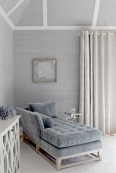 Light grasspaper with white accents and similar colored velvet chaise.