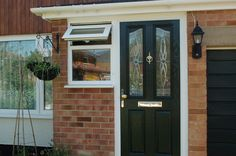 Solidor Composite Black Front Door, Obscure glass side window and roofline products. ksehome.co.uk