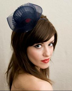 Navy with red accent hair accessory for bridesmaids