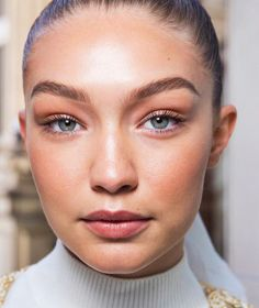 Gigi Hadid with peach toned makeup - peach tones are huge for spring 2017.