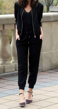 Must have affordable shoes of the moment! - Fashion blogger Marie's Bazaar styles these velvet block heel pumps from Asos with black joggers and a black bomber jacket from Dynamite Clothing