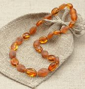 """Amber teething necklace   Amber is not a """"stone"""" but a natural resin. So as it warms with the body's natural temperature, amber releases its healing oils (these oils contain succinic acid) which are easily absorbed into the skin and then into the bloodstream. Baltic Amber has some of the highest concentrations of Succinic Acid found in nature. Succinic Acid is a natural component of plant and animal tissues, and it's presence in the human body is beneficial in many ways."""