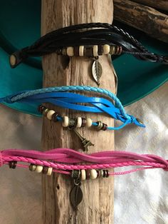 Leather Multi Strand Bracelet Set. One Teal Blue with a Eiffel Tower charm. One Pink with a Leaf charm. One Black with a Leaf charm. All have plastic beads & wood beads. Beads are free floating, so they move around!  Two brass snaps 8 adjustable to 7.5 in Length. Shipping to the USA only. I use USPS Economy Shipping is $2.75   Thank you for looking, pinning, sharing, tweeting, joining, circling, favoring, following, shopping & buying