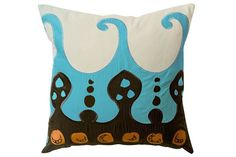 Cotton pillows layered and textured with applique and embroidered colors reminiscent of Egyptian textiles.