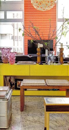 yellow cabinet + orange tiles behind the tv