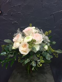 Fragrance Bridal bouquet with O'hara roses, lisianthus, ranunculus, eucalyptus berries, soft ruscus,silver leaves.