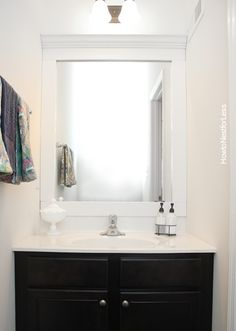How to Frame a Bathroom Mirror - How to Nest for Less™
