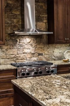 Kitchen Backsplash Stone natural-stone kitchen backsplash tiles types dark wood cabinets