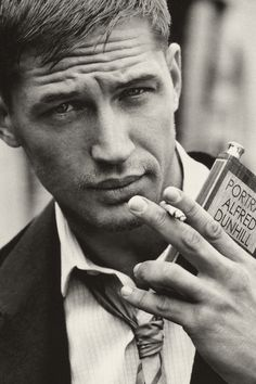 """I'm from a nice, suburban, middle-class family, but my tattoos remind me where I've been."" ~ Tom Hardy"