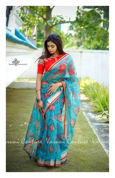 Color : Red And Sky Blue Fabric: Linen Length: Standard mtrs Blouse Piece: Included Wash Instructions: Cold Wash Only Saree Jacket Designs, Saree Blouse Neck Designs, Saree Blouse Patterns, Fancy Blouse Designs, Bridal Blouse Designs, Red Blouse Saree, Dress Patterns, Stylish Blouse Design, Saree Trends