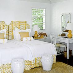 GUEST BEDROOM - Island Elegance - Treat your guests to a stay in paradise. Bamboo-inspired furniture and tropical bedding create an atmosphere as fun and relaxing as a Carribbean Escape.  would be fun to try putting the two single beds together .. i also like the white with golden yellow accents and the ceramic accent seats. 25 Charming Guest Rooms | Island Elegance | CoastalLiving.com