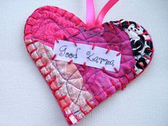 "Good Karma Valentine Heart Ornament Charm  MusicTeachah   This handmade hanging valentine heart is made from recycled fabric scraps in bright batiks and colorful felt. This retro, boho and funky heart reads ""Good Karma"" and is hand stitched together using bright contrasting embroidery threads. It hangs from a vibrant hot pink satin ribbon.    These hanging hearts make the perfect gift for the free spirited, hippie, and bohemian soul in your life... or as a gentle reminder for you to follow…"